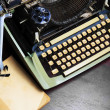 Old typewriter and old book on the table. — Stock Photo