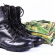 Military camouflage uniforms and boots Through use. — Stock Photo #10469240
