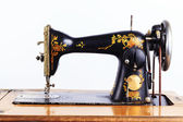 The old sewing machine on a white background — Stock Photo