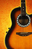 Acoustic guitar on abstract background. — Stock Photo