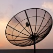 Black antenna communication satellite dish over sunset sky — Stock Photo