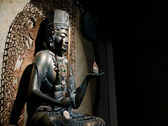 Bronze Buddhist statue — Stock Photo