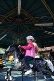 Grl on carousel — Stock Photo