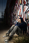 Young man in alley — Stock Photo