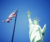 Statue of Liberty and American Flag — Stock Photo