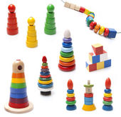 Very many colorful wooden pyramidions fnd beads toy on white bac — Stock Photo