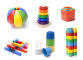 Many colour kids toys on white background — Stock Photo