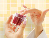 Female hands with a cosmetic cream — Stock Photo