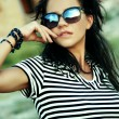 Stock Photo: Fashionable young womin sunglasses