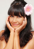 Young beautiful woman with flower — Stock Photo