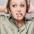 Young beautiful woman with headset — Stock Photo