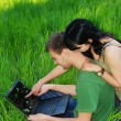 Stock Photo: Young couple with laptop outdoor