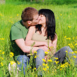 Young beautiful woman kissing outdoor — Stock Photo