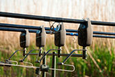 Four spinnings with carp bite indicators — Stock Photo