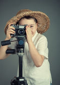 Boy with a camera — Stockfoto