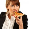 Young happy business woman eating pizza — Stock Photo