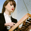 Businesswoman with wooden abacus. — Stockfoto