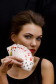 Lady with the fan of playing cards — Stock Photo