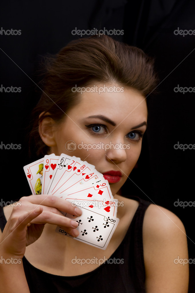 Lady with marvelous eyes keep the fan of playing cards in her hand — Stock Photo #8959207