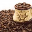 Coffee cup on the beans — Stock Photo
