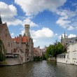 Most common view of medieval Bruges against blue cloudy skies. — Stock Photo