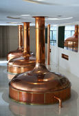 Line of three brewing vessels in brewery. — Stock Photo
