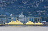 Yellow mountains of sulfur to be shipped out of Vancouver port ( — ストック写真