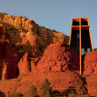 Royalty-Free Stock Photo: Sunset colors the red rocks even redder around the iconic Christ