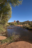 Oak Creek and Cathedral rock in distance near Sedona. — Stock Photo
