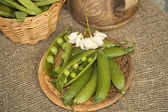 Pods of peas on the table — Photo