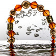 Jewelry, bracelet with water splash — Stock fotografie