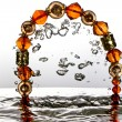 图库照片: Jewelry, bracelet with water splash