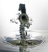 Watch, wristwatch, jewelry with water splash — Stock Photo