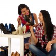 2 young women woth shoes, show shopping — Stock Photo