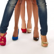 Female legs with different shoes, womens legs — Stock Photo #8992645