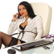 Sexy secretary at work, at her office desk — Stock Photo
