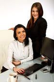 2 business women, secretaries working in office — Stock Photo