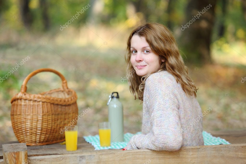 Beautiful caucasian girl at picnic in forest — Stock Photo #8897828