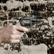 Hand with gun — Stock Photo