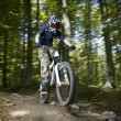 Downhill mountain bikers — Stock Photo