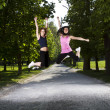 Young girls jogging in the park — Stock Photo