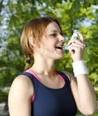 Young girl with asthma inhaler — Stock Photo