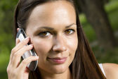Beautiful young girl talking on the phone — Stock Photo