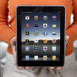 Stock Photo: Woman holding Apple iPad 2
