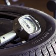 Guage meter on a tire - Stock Photo