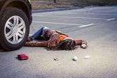 Woman Lying on the pavement — Stock Photo
