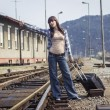Stock Photo: Young woman waiting for the train