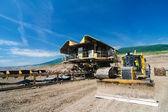 The belt conveyor and bulldozer — Stock Photo