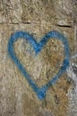 Rock surface with a blue heart — Stock Photo