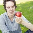 Young man holding an apple — Stok fotoğraf